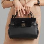 Černý kožený kufr